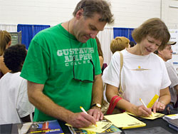 Fair-goers stop by the Gustavus booth to send a Gustie Gram.